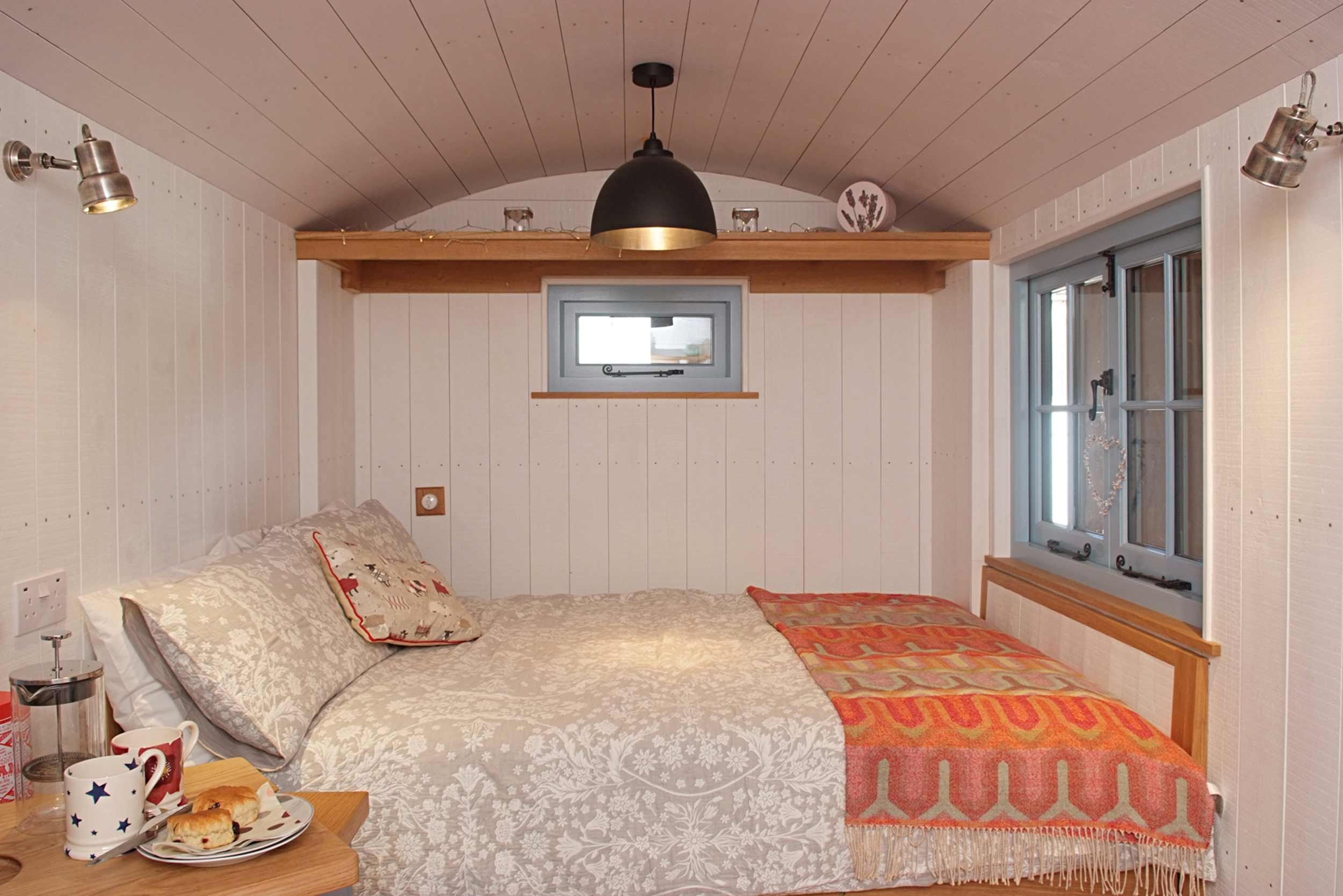 Shepherds Hut Bedroom End with Luxurious Fold Down Double Bed