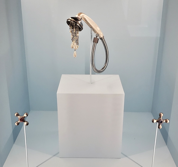 Karl Lagerfeld for Chloe showerhead necklace and knob earrings.