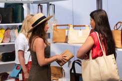 Indigo boutique buying from Payton James' line Accessories Council booth.