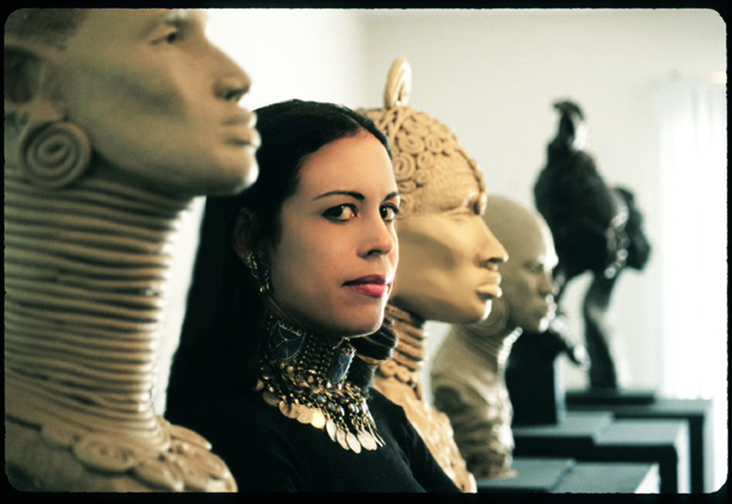 Toni Scott with Sculptures.jpg