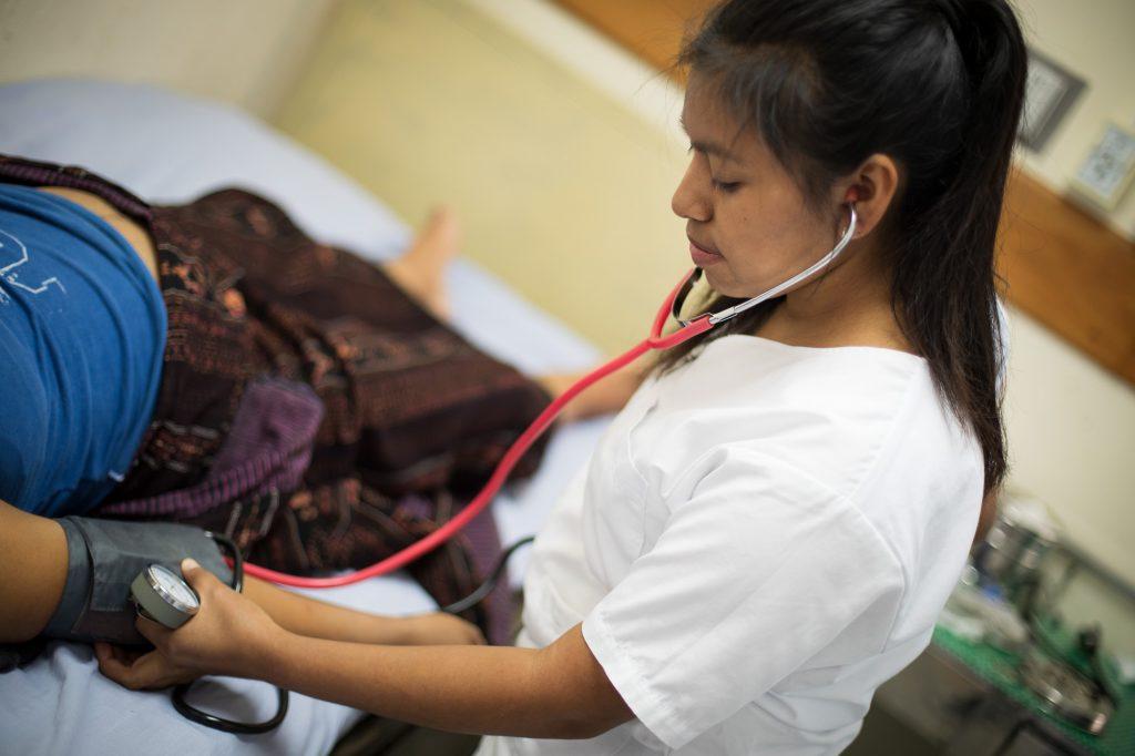 Andrea taking vitals at the local hospital.jpg