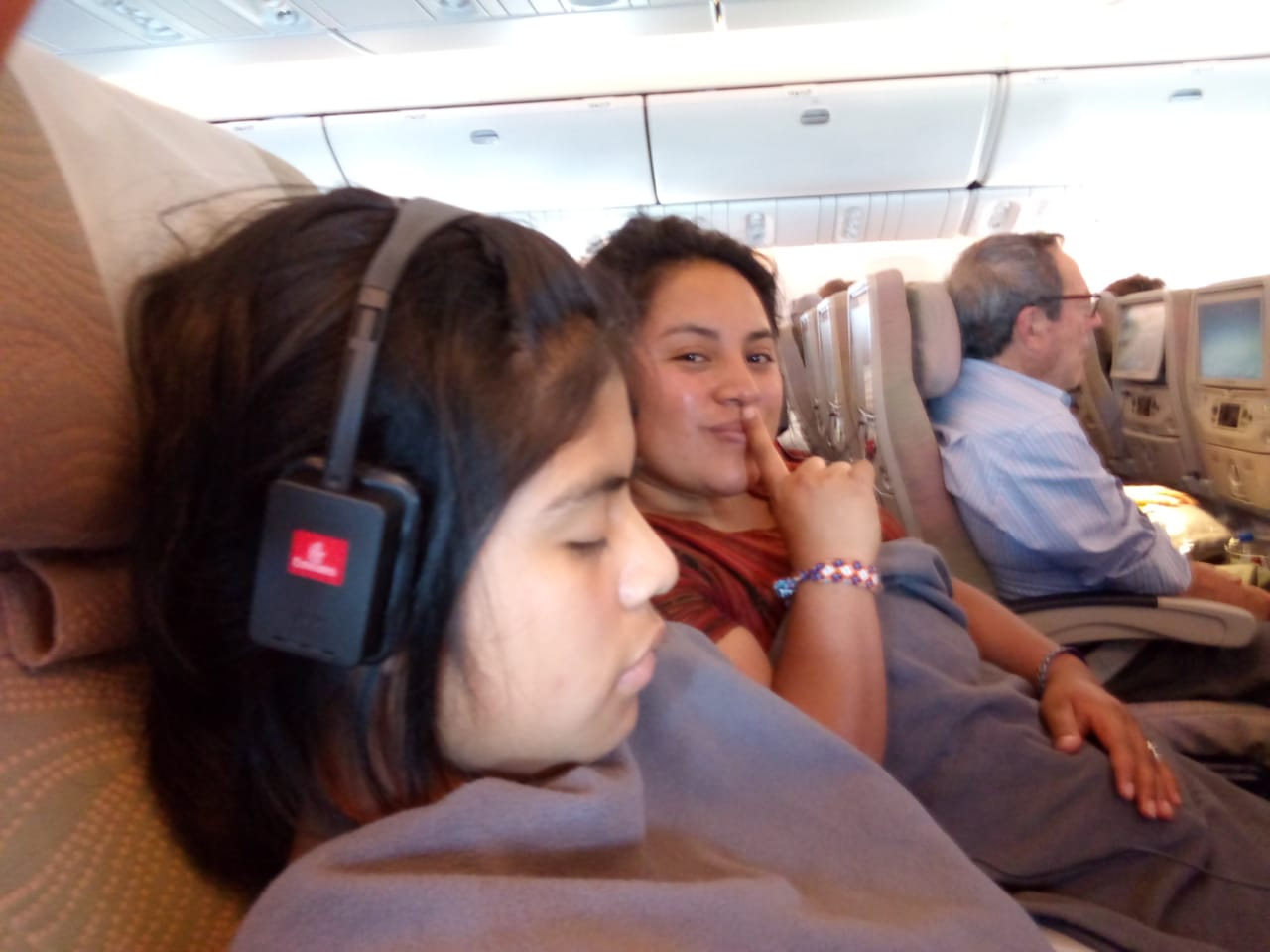 Ester finally getting some sleep on the plane, with Vilma in the background.   Photo: Lidia Oxi