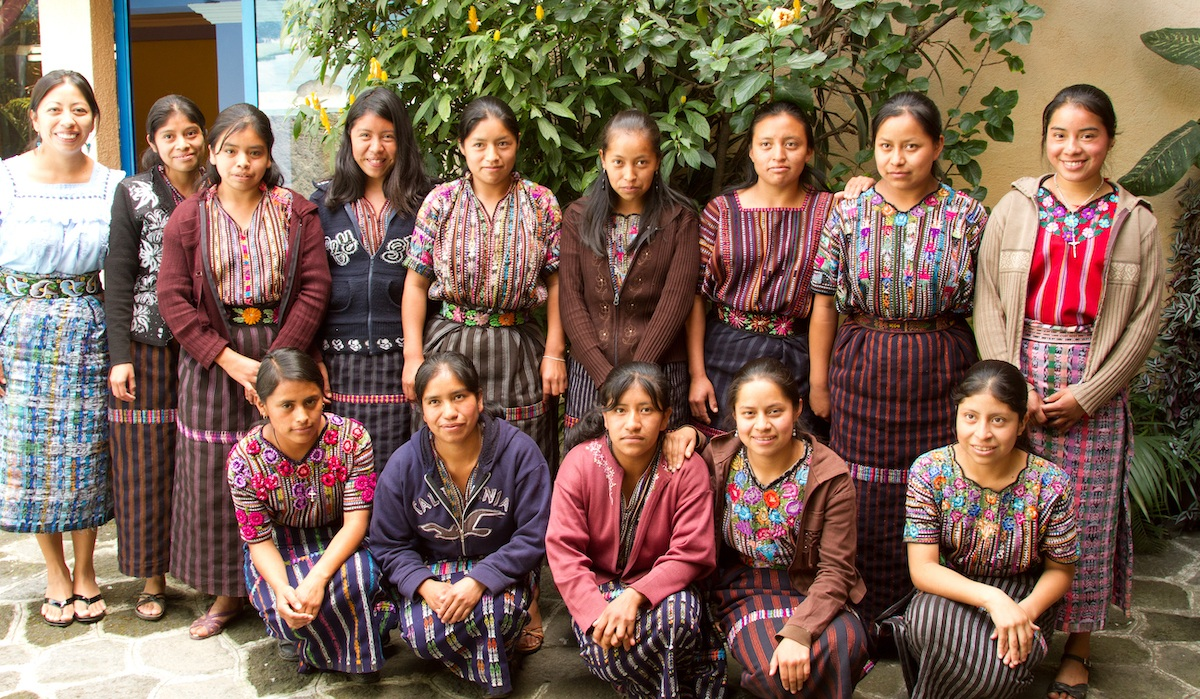 Mayra, far right in the front row, with her mentorship group in 2012. Three of the Girl Pioneers in Mayra's mentorship group are now her co-workers at the MAIA Impact School.
