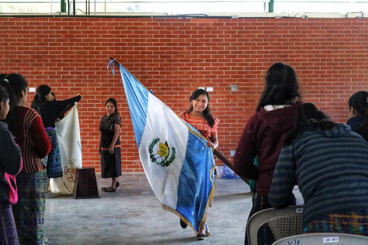 Girl Pioneers during the Student Government Inauguration carrying the Guatemalan Flag
