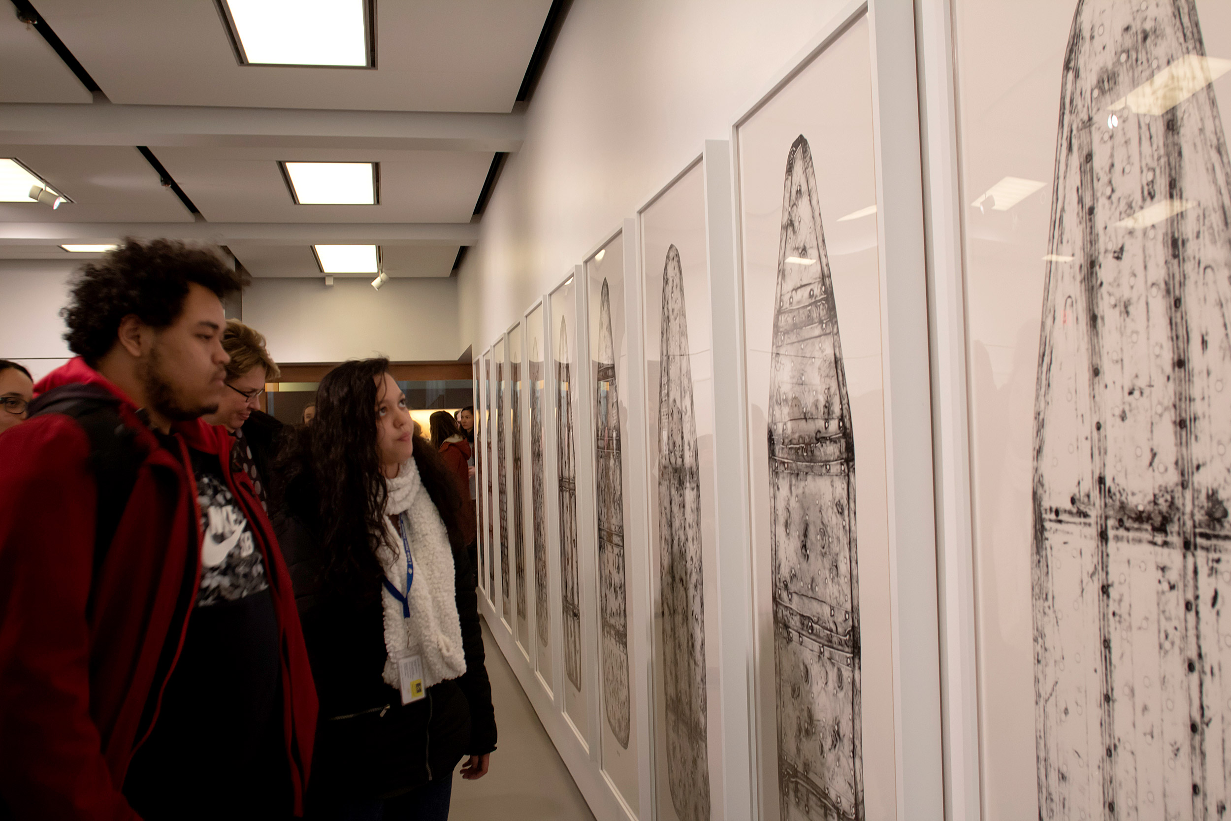 Noel Pichardo and Jasmin De La Cruz, student artists from RAW Art Works in Lynn, view the gallery.  Photo by María F. Sánchez