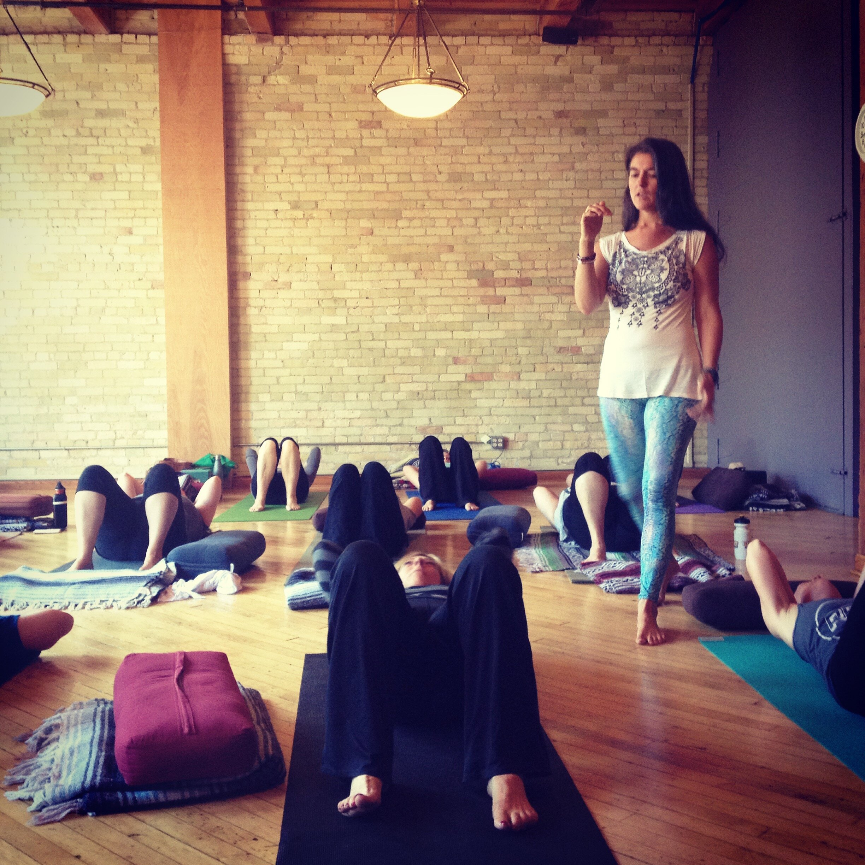 Leading restorative yoga practice in Milwaukee, WI.