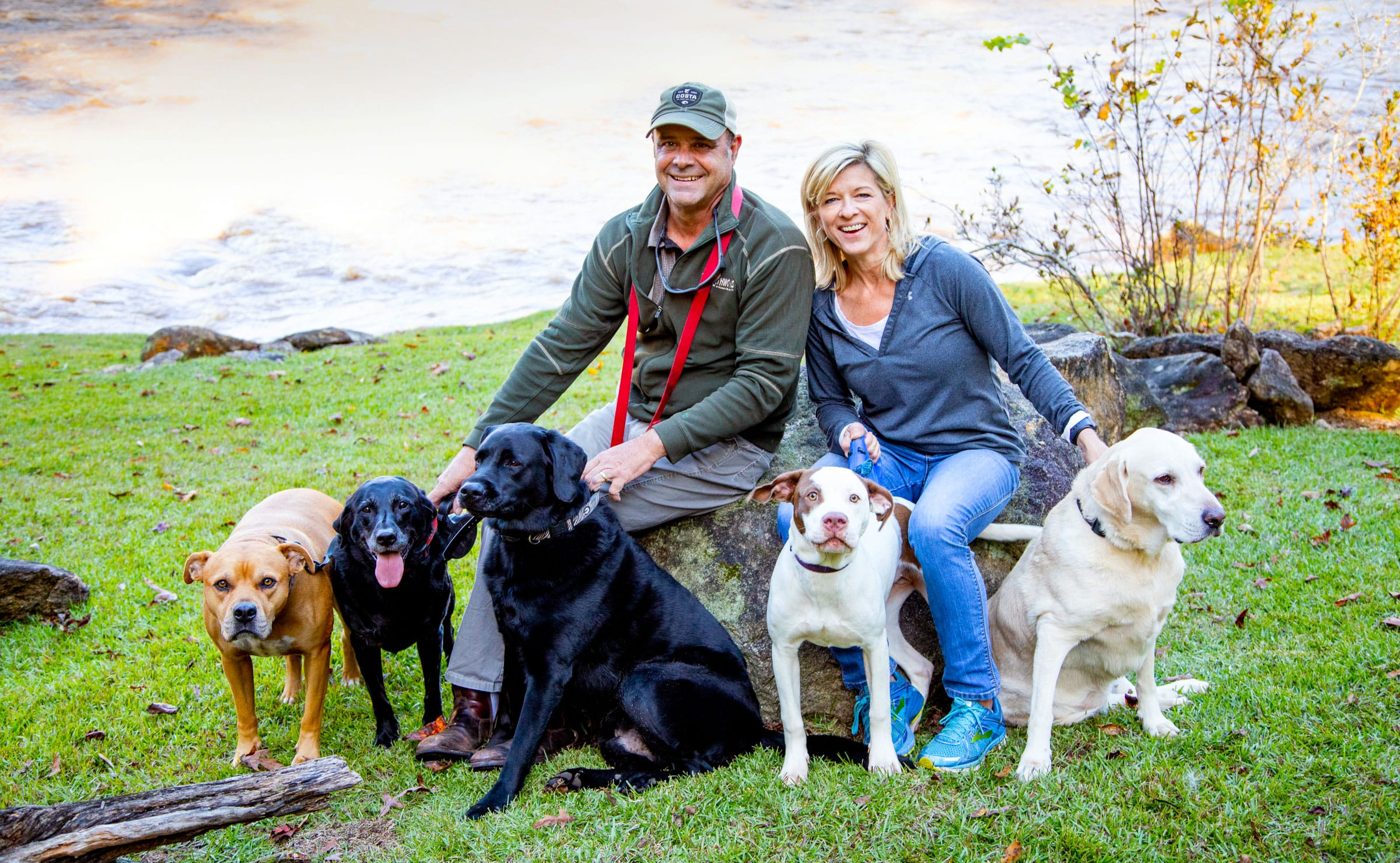 Holly and her husband Scott with their four rescues and one foster