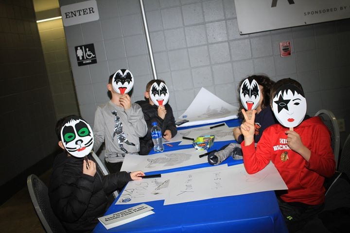 Kids with KISS masks.jpeg