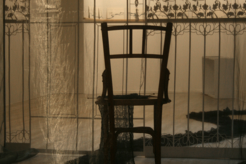Inside the room / a chair / knitting needles as weapon of creation  A Room of one's own  2012 / Installation · Variable sizes