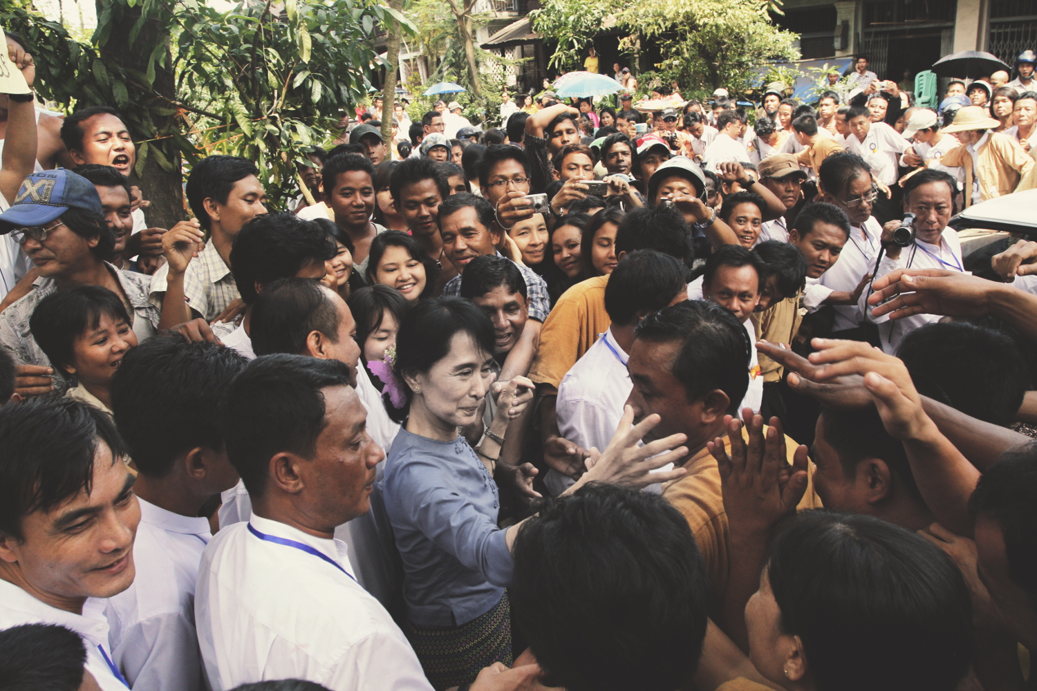 Aung_San_Suu_Kyi_greeting_supporters_from_Bago_State_ed-sat.jpg