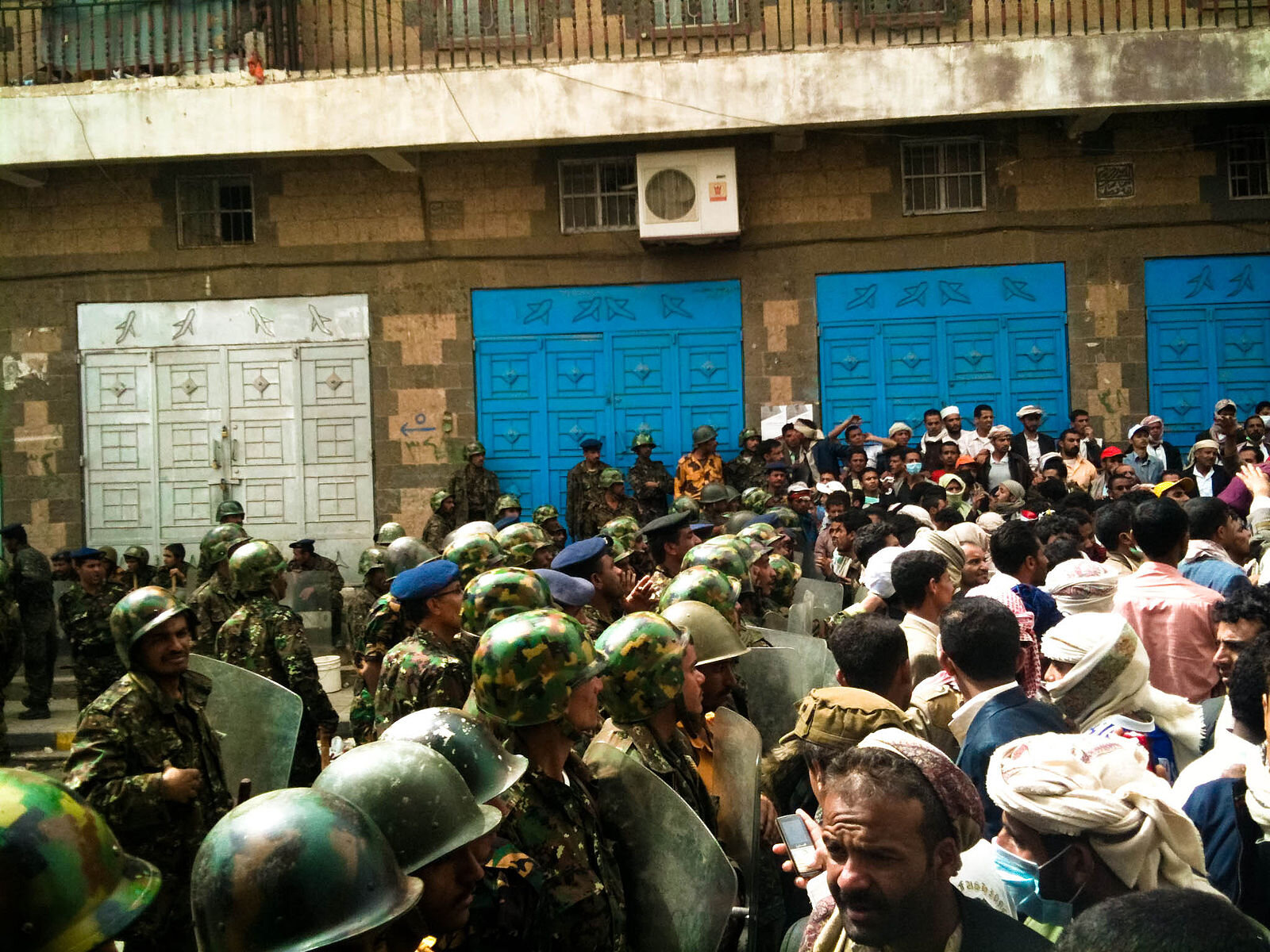 Protestors face security forces in Sana'a in 2012.