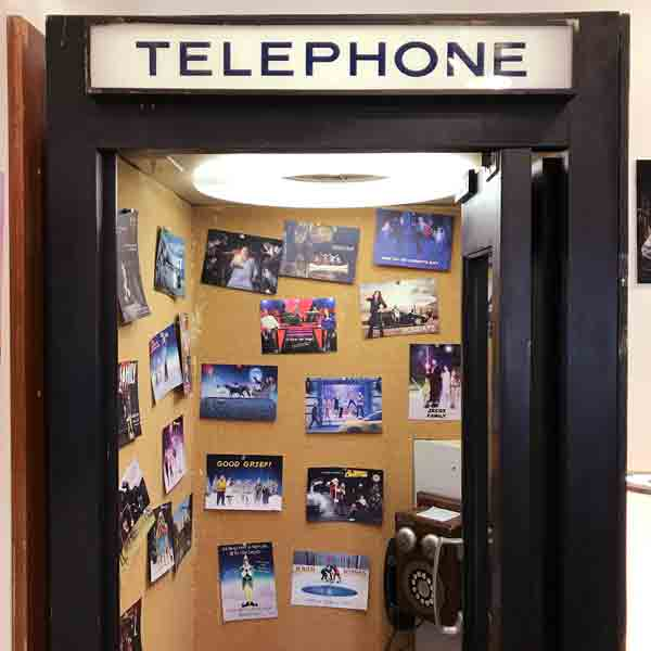 When a client mails me back a card, it goes up in the phone booth!