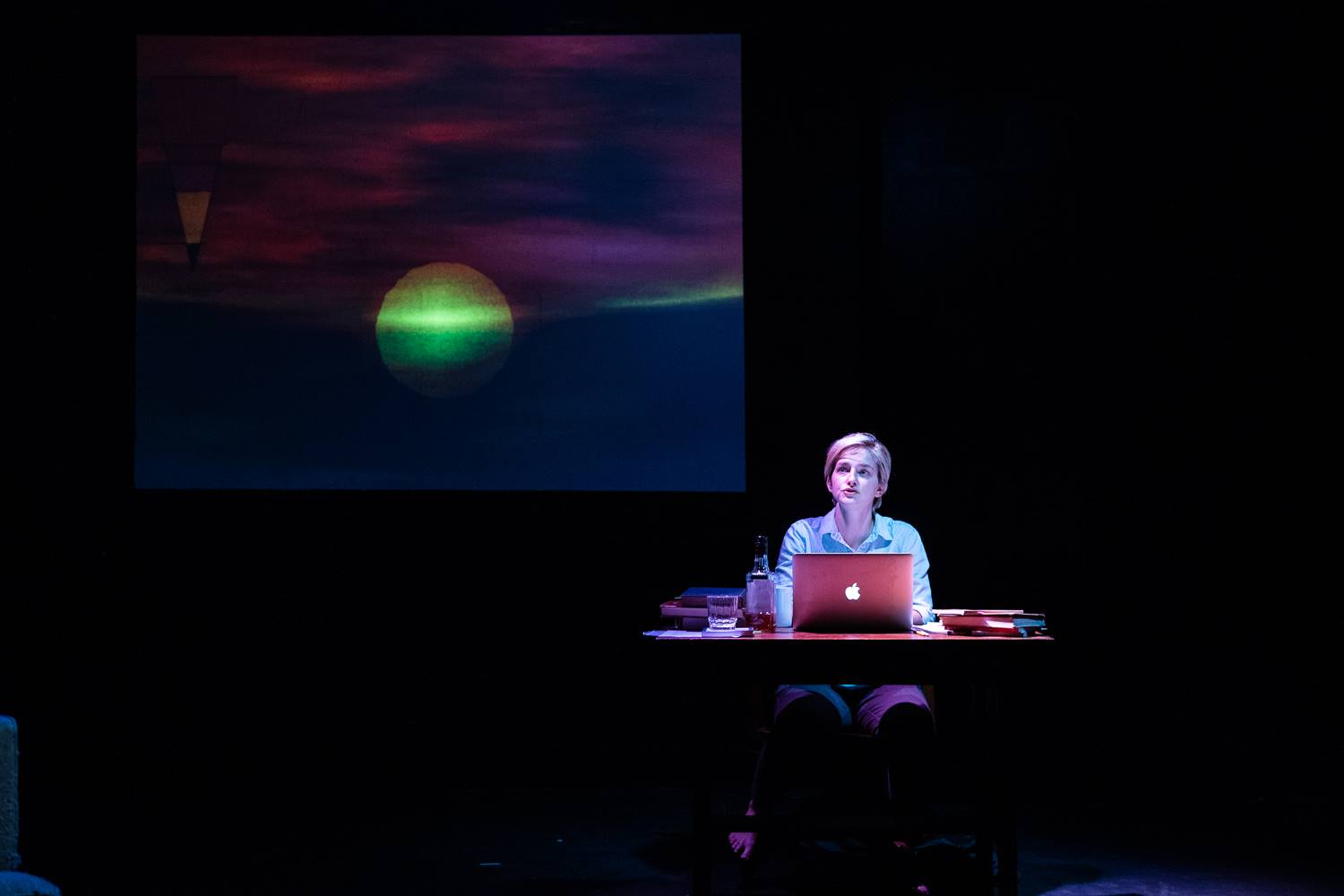 Ellenor Riley-Condit as Writer in  Bluets , based on the book by Maggie Nelson, at IRT in NYC. Video design by Adam Stone. Photo by Al Foote III.
