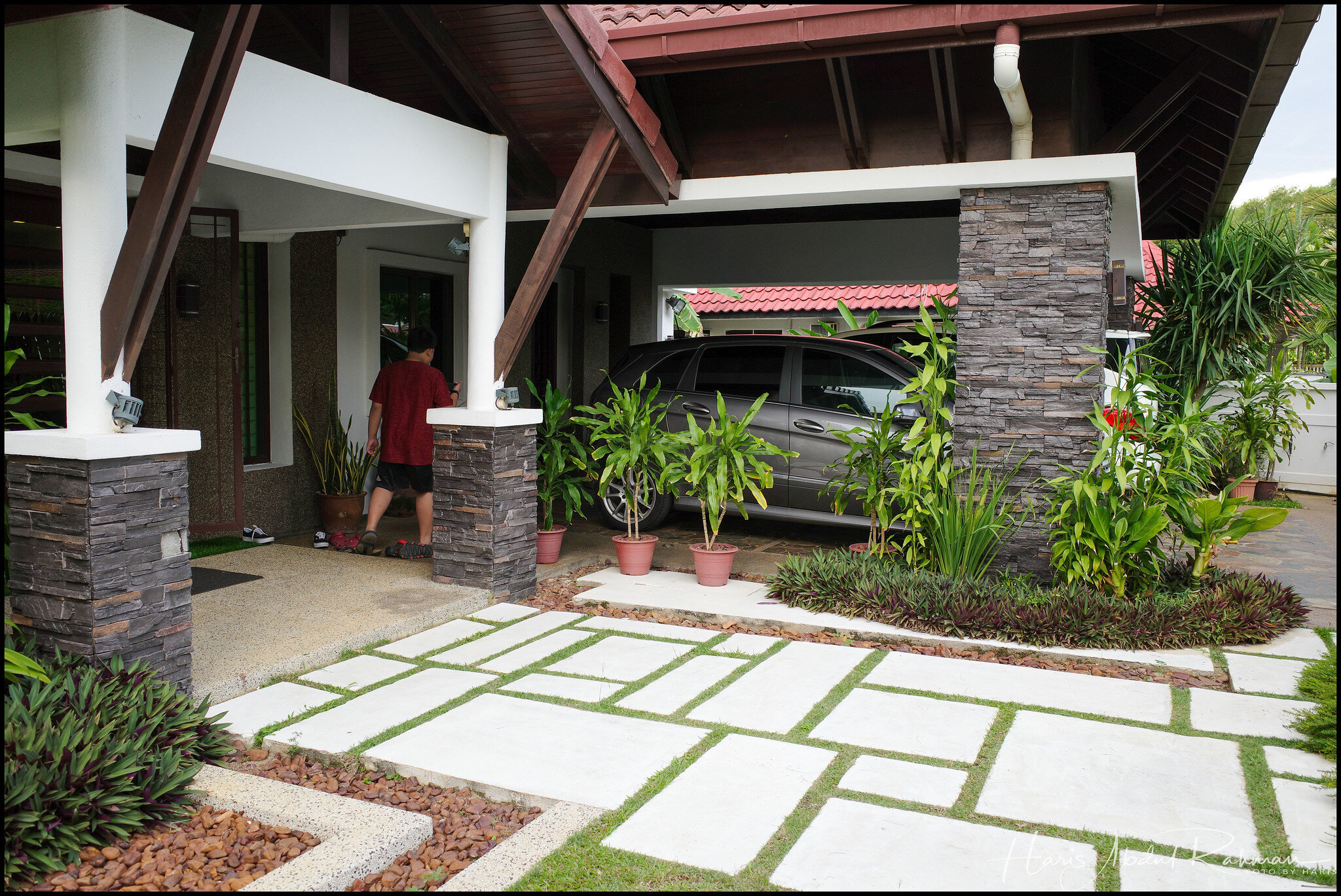 The front porch with Azie's and Syahril's car in the driveway