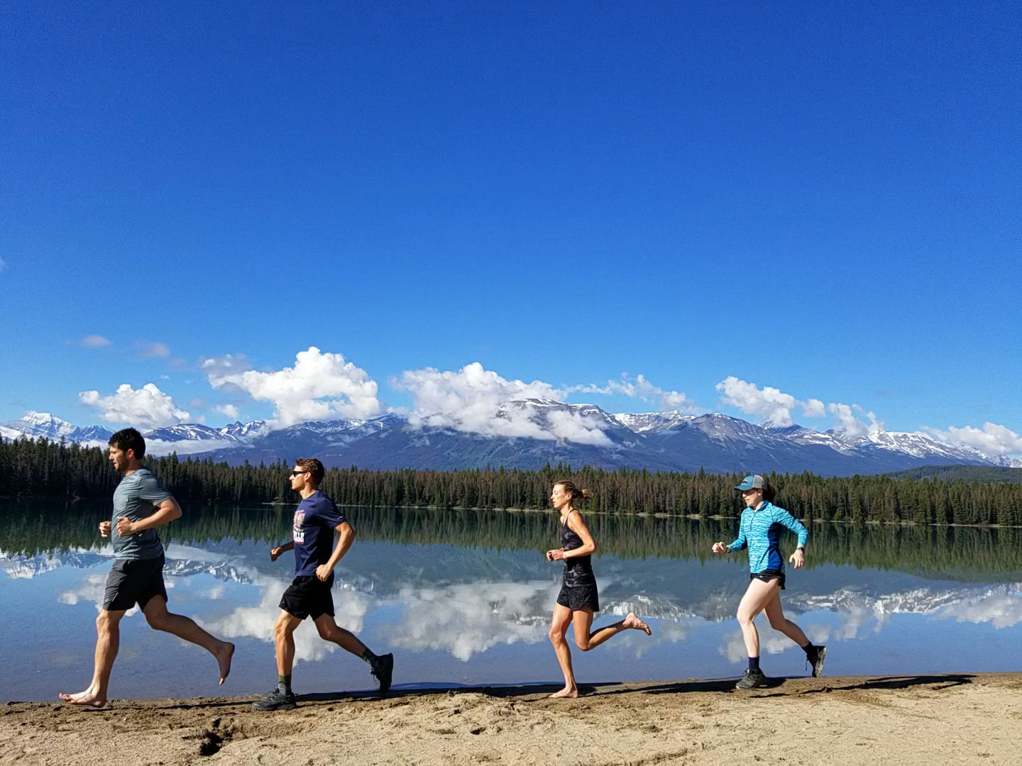 Trail running with Ryan, Paul, and Annie in June up in Jasper, Alberta. Missing these humans. (I made them take this photo a few times)