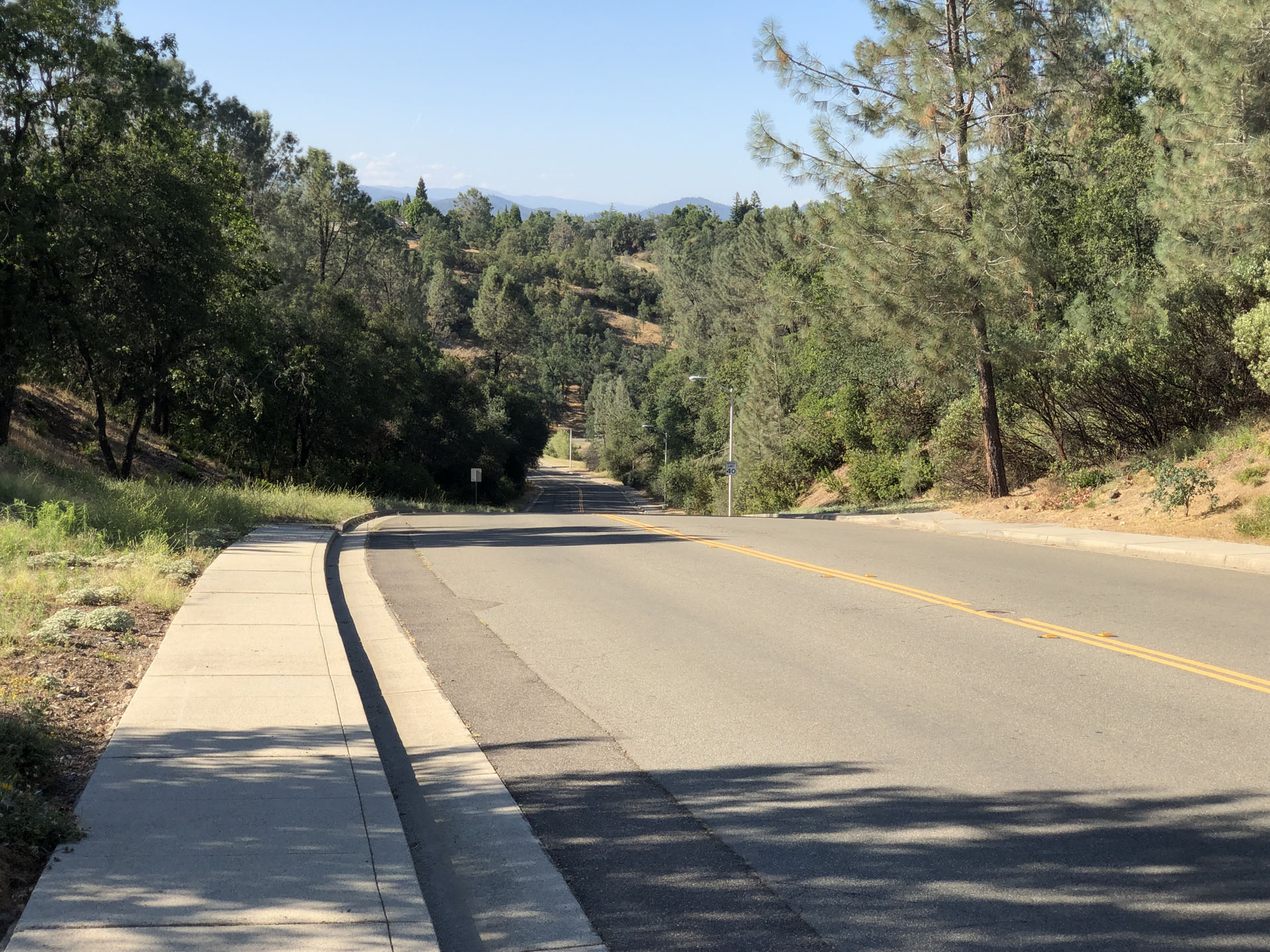The presence of sidewalks greatly diminishes the chances of being struck by a vehicle while jogging up the hill, costing it points: fear is a great motivator.