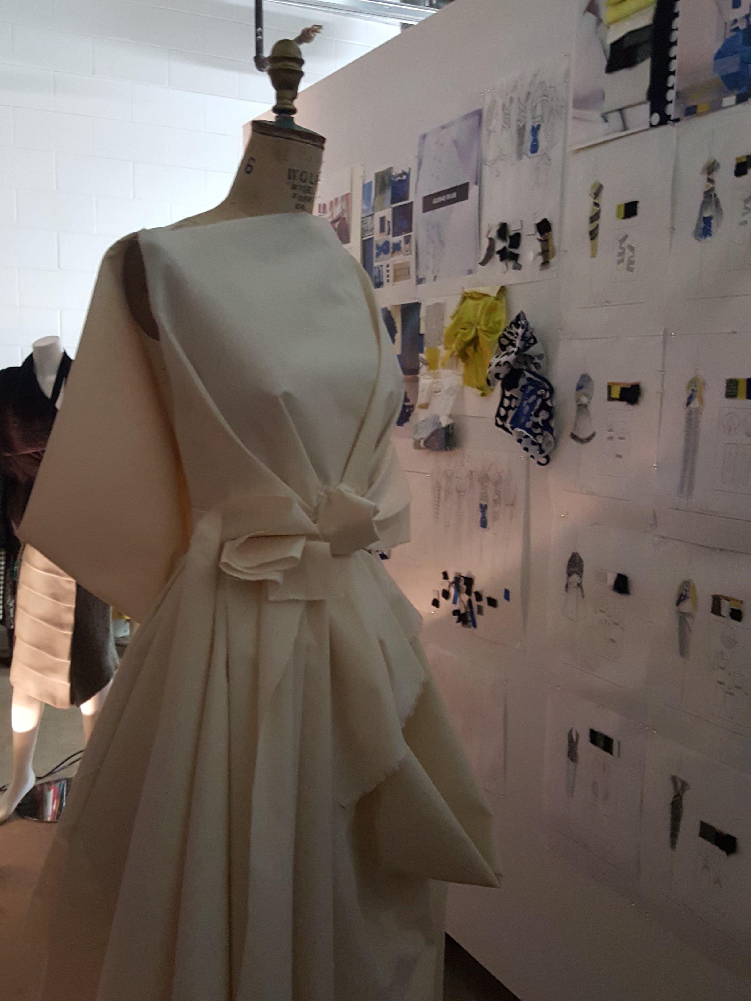 Anderson self draped muslin dress and wall with my sketches and inspiration.jpg