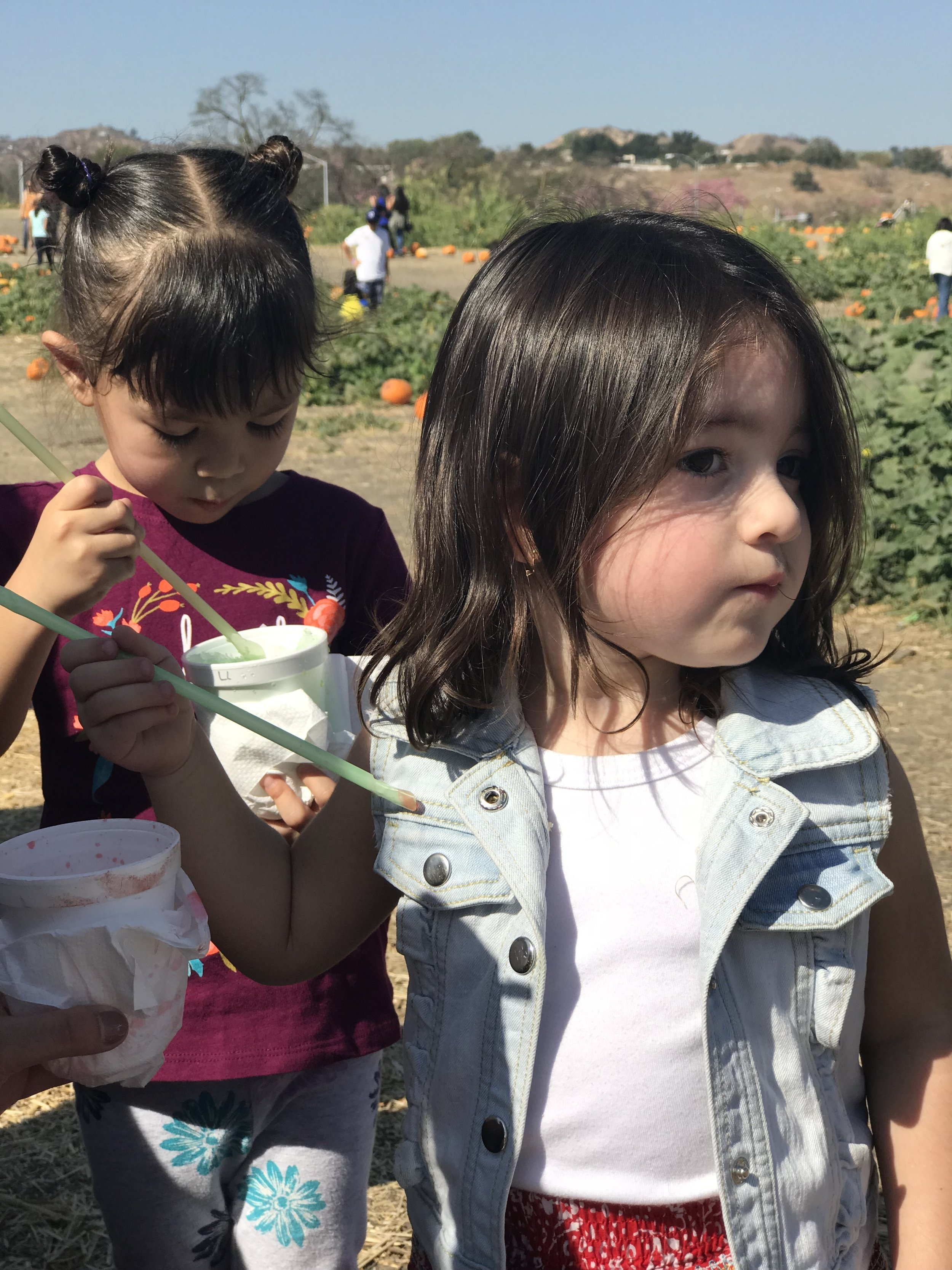 At a pumpkin patch with her cousin Camila