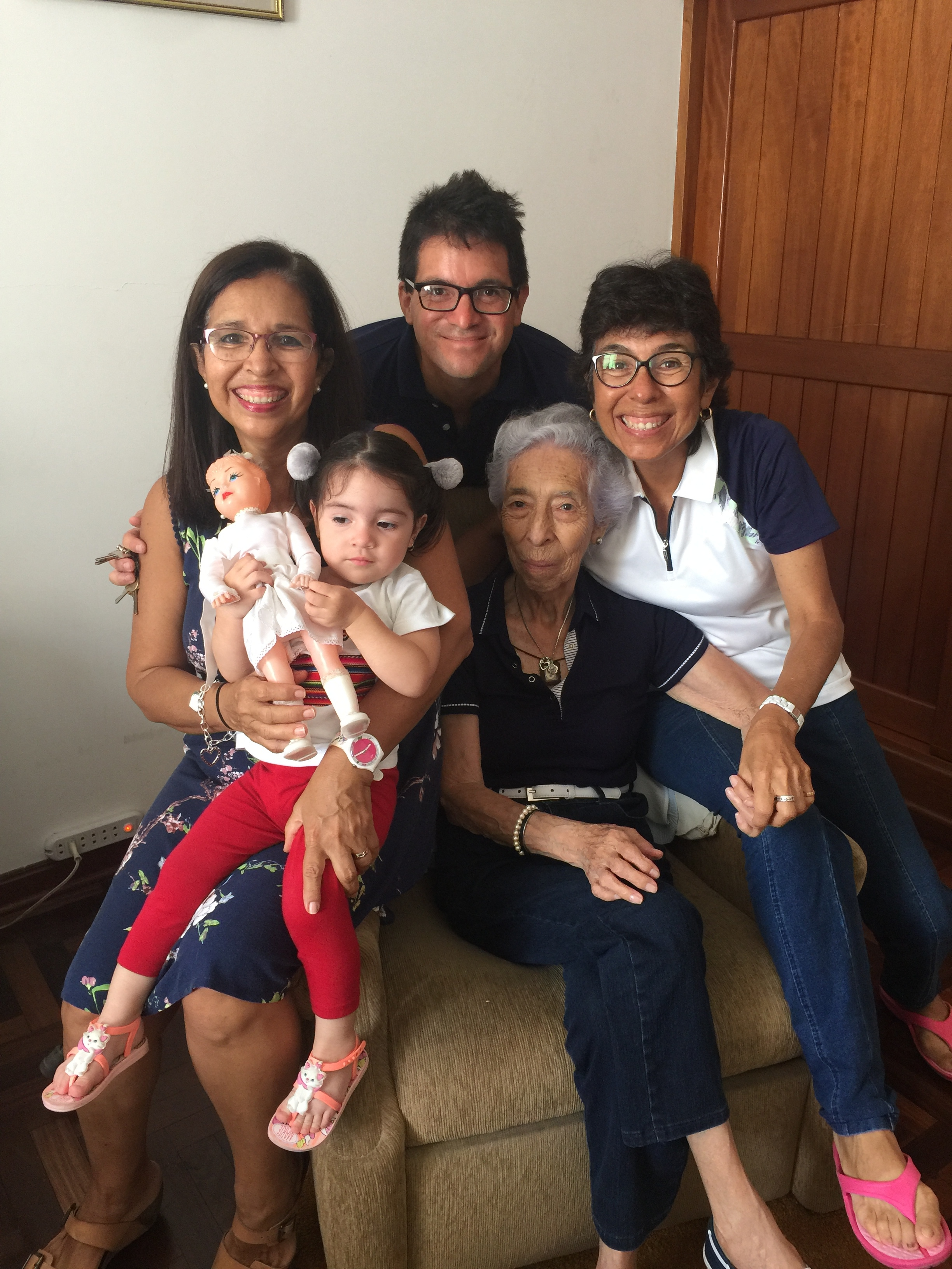 With abuelita Rosita, Tia Camu and Tia Paty, holding one of the many Abuelito Alberto Doll Toys