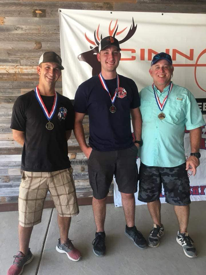 Pro Staffer Sam Thrash (middle) receiving one of three medals he won at the 2018 Texas Firefighter Olympic Archery Games