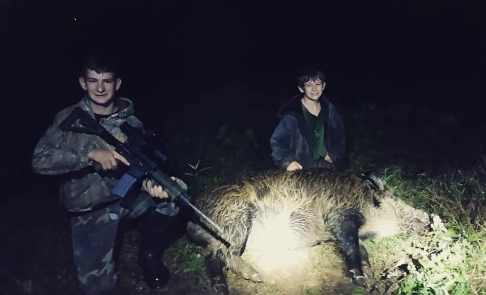 Pro Staffer Nick Latham's sons, Byron and Dawson with their trophy boar!