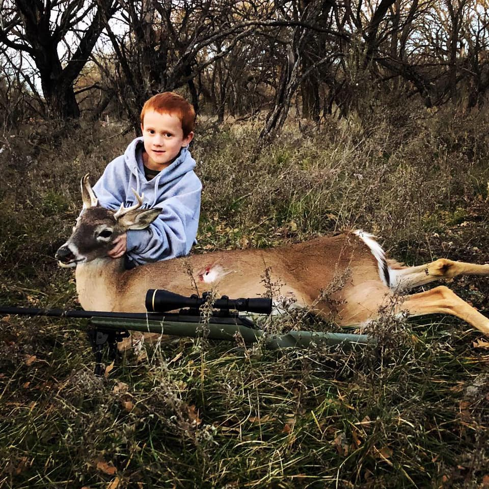 Administrator Chester Barnes' 6 year old son, Layne with his very first deer!
