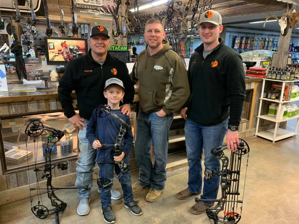 From left, Admin Chester Barnes, his son Layne, Cinnamon Creek Archery Manager Kyle Chambers, and Admin Sam Thrash after getting Layne set up with his first bow