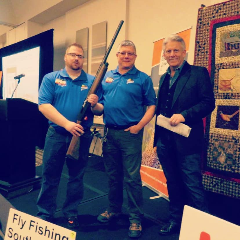 Field Staffer Tim Berges (left) helping at his local Pheasants Forever Banquet