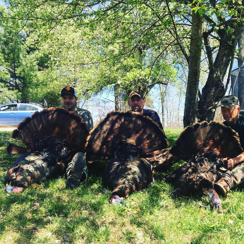 A triple kind of day with Field Staffer Jason Wandling (far left) and friends