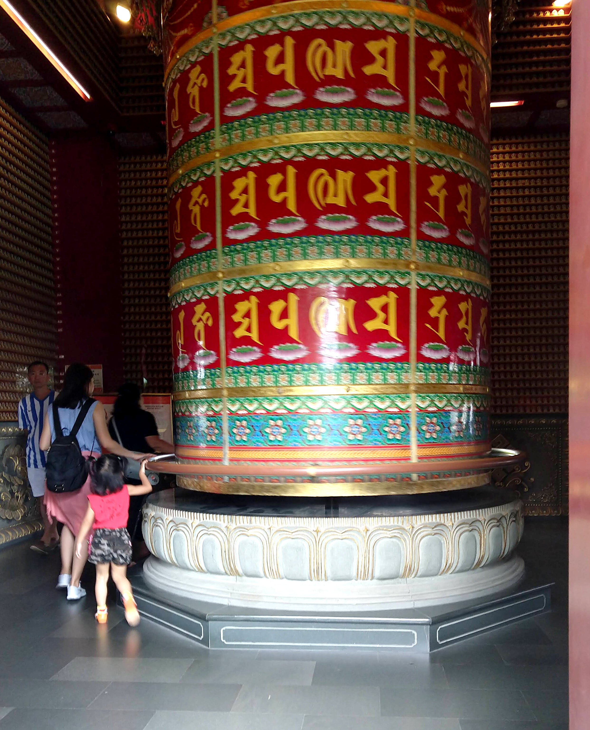 The largest cloisonné prayer wheel in the world, at the Buddha Tooth Relic Temple in Singapore. You hold onto a handrail to turn it.