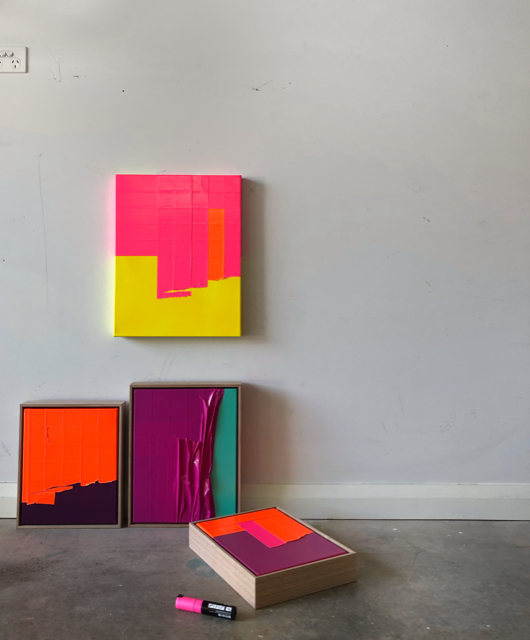 Small contemporary artworks against wall