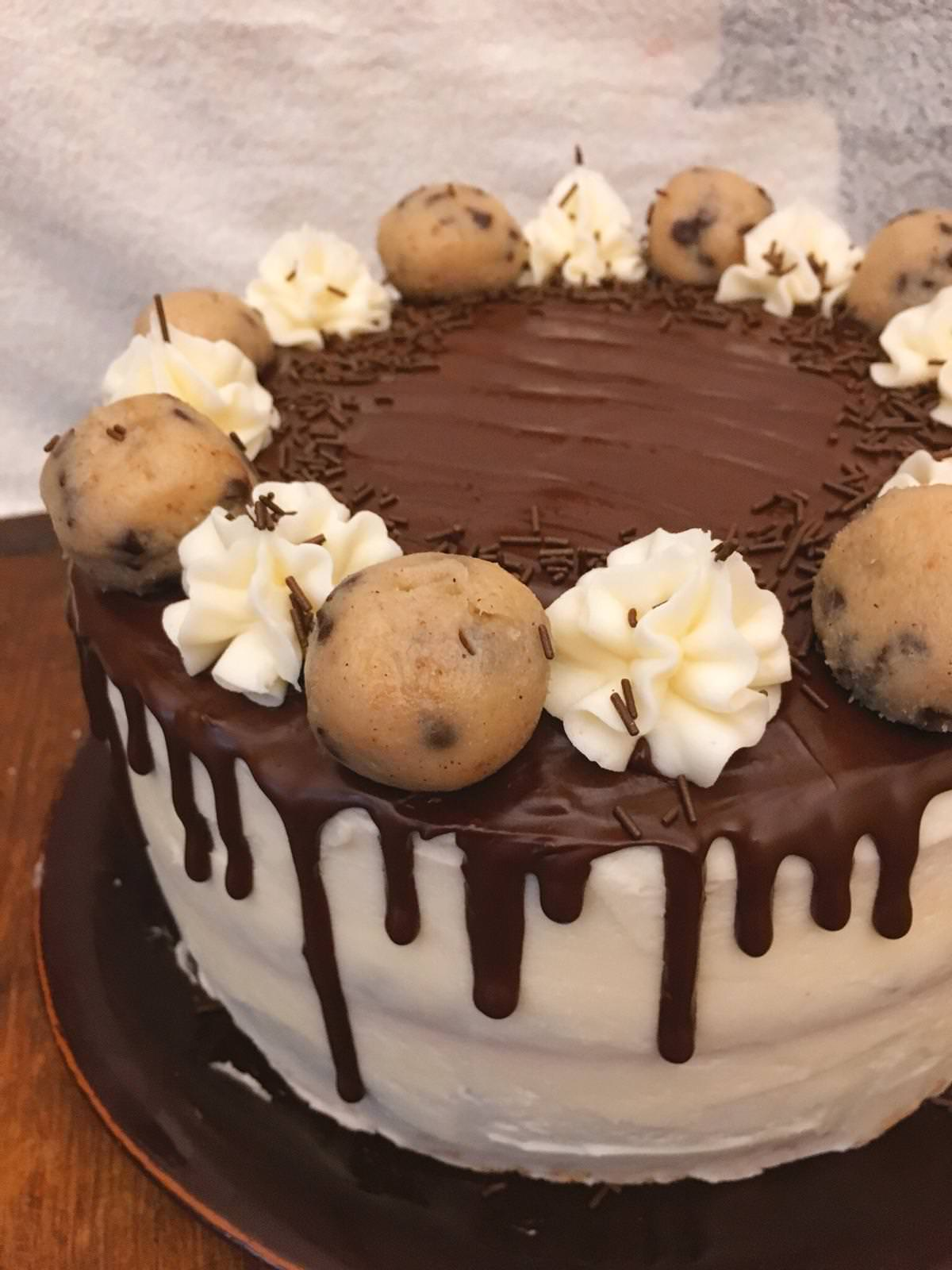 There is nothing more delicious than this chocolate chip cookie dough cake with cookie dough buttercream and vanilla ice cream frosting.