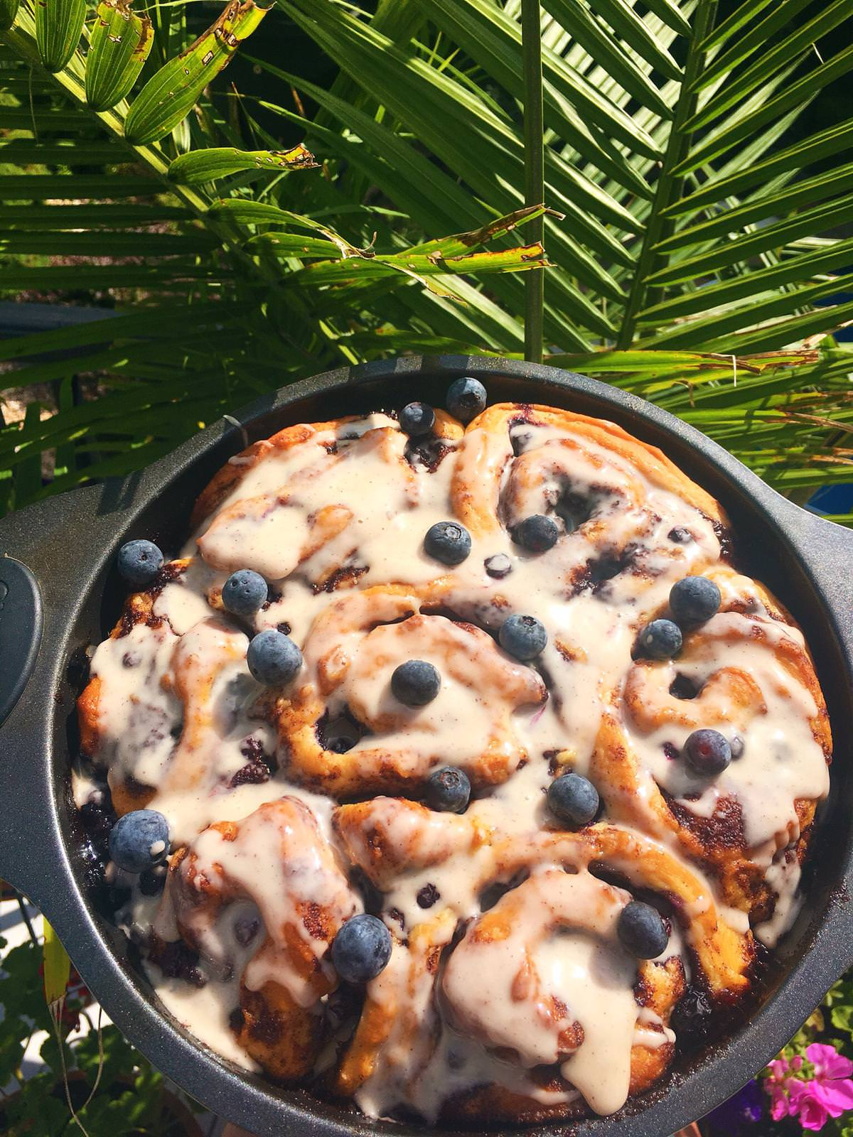You'd never know these blueberry cinnamon rolls were vegan. This dairy free homemade cinnamon roll recipe will knock your socks off!