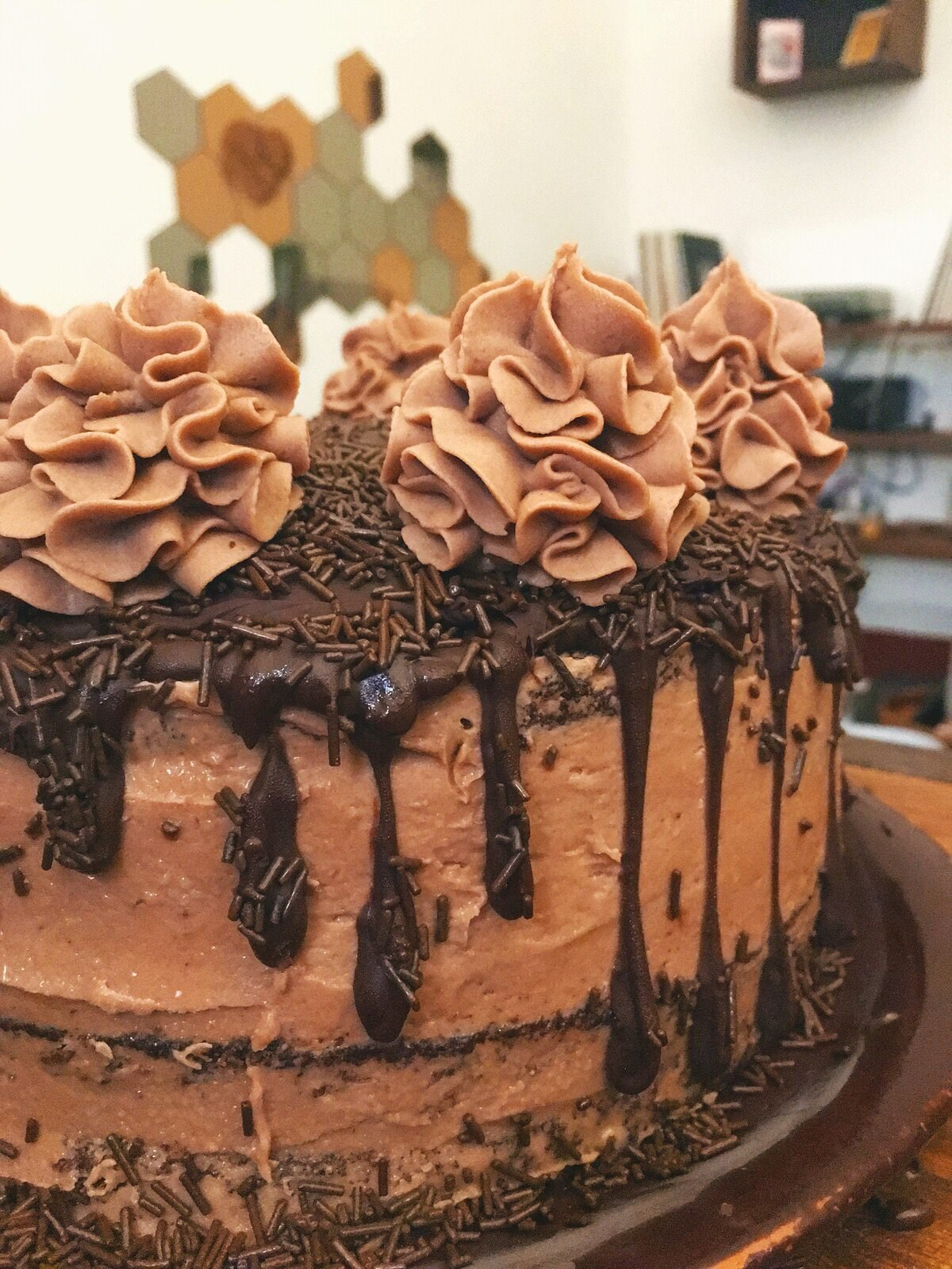 This Nutella and chocolate cake is packed with rich flavor! The Nutella buttercream is to die for!