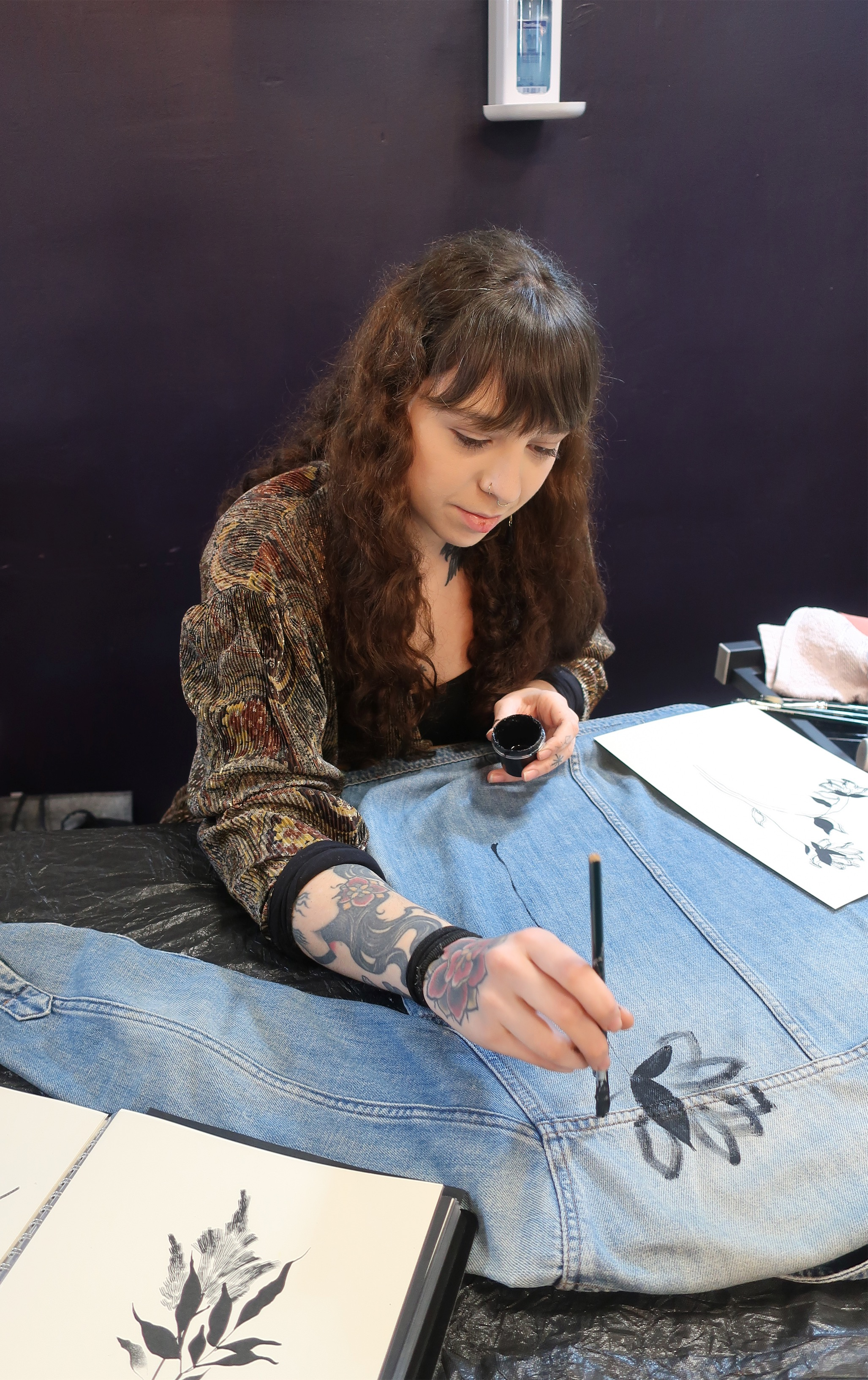 Artist Alba Rey handpainting on denim.jpeg