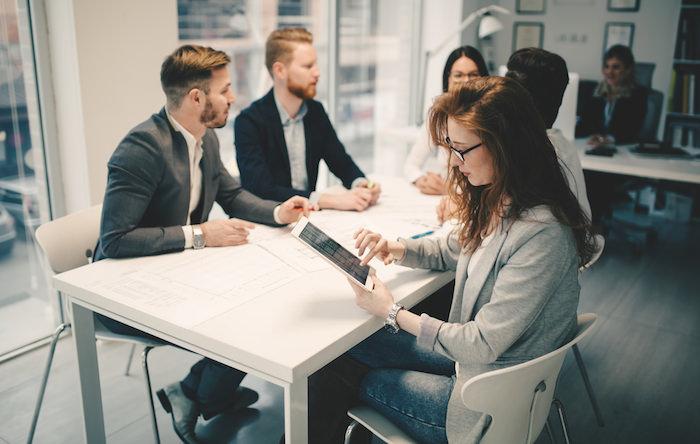 millennials brainstorming in office.jpg