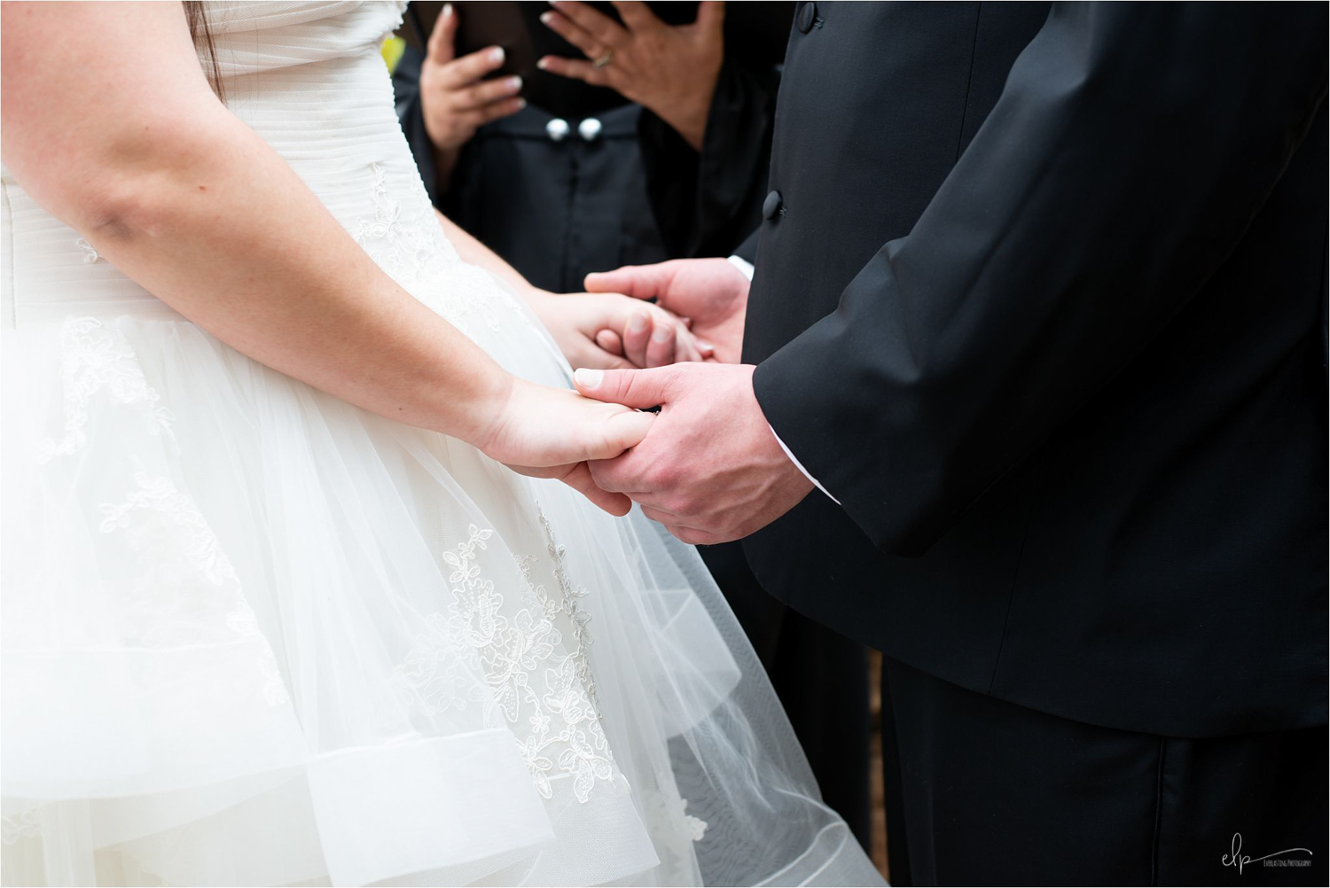 Couple holding hands.