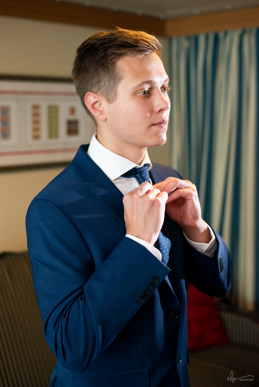Groom getting ready wedding photographs on disney cruise line