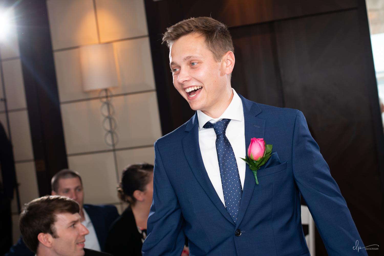 groom in outlook lounge wedding on disney cruise