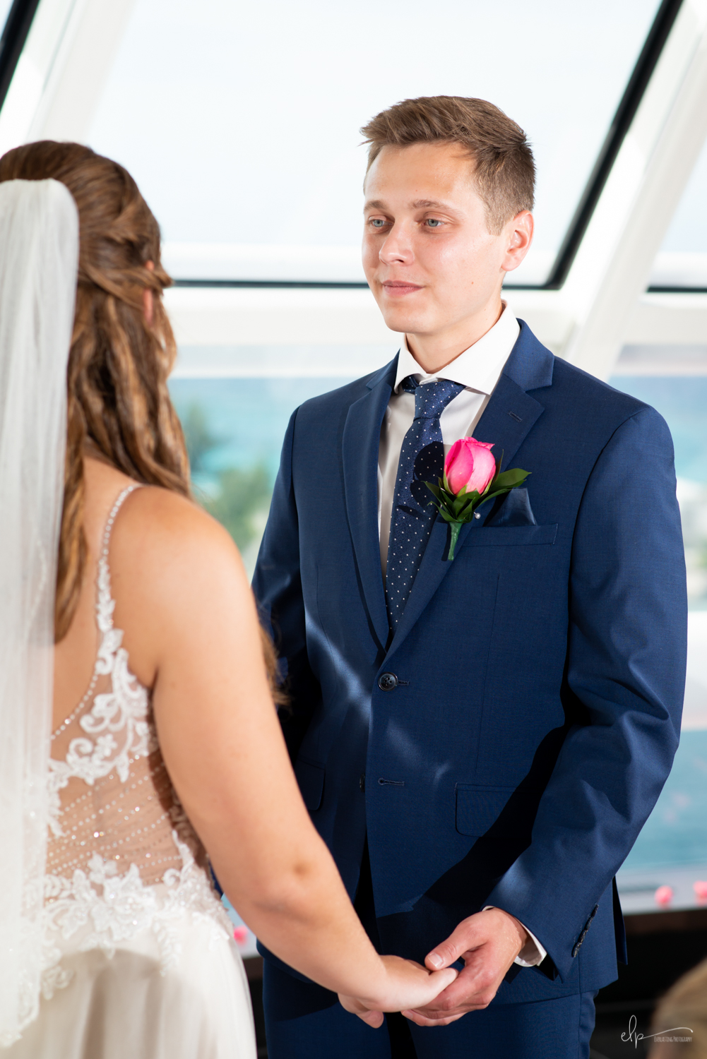 wedding ceremony portrait in outlook lounge on disney cruise