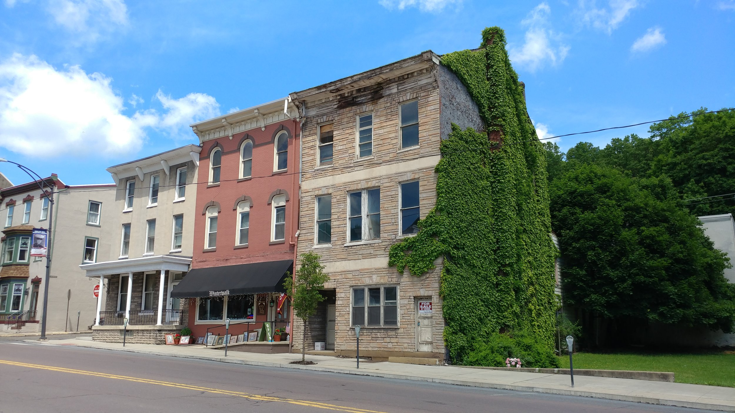 The Mercy House of Ashland property (the row home with the green ivy) not long after it had been donated.
