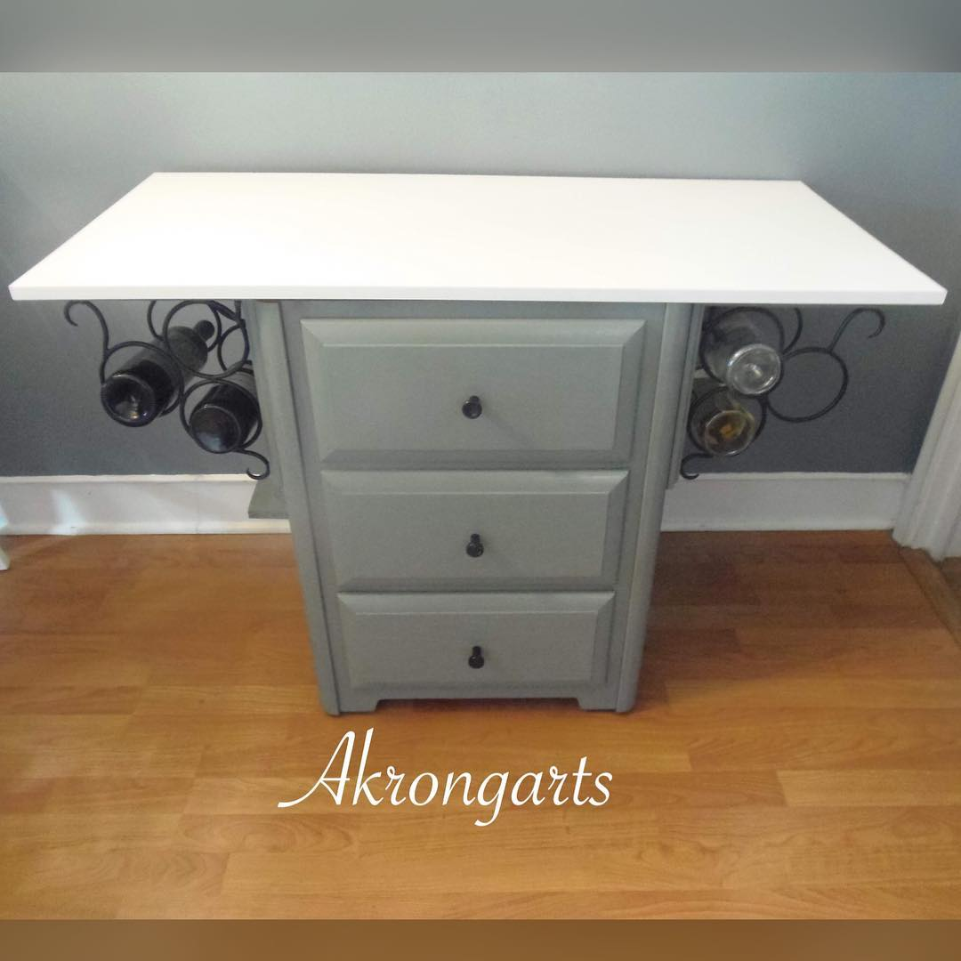 Would you believe me if I told you that this wine rack kitchen island started life as an old desk?!