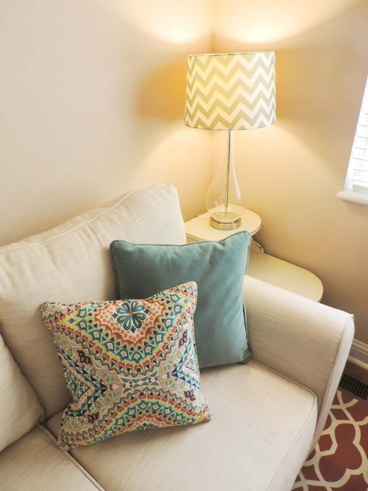Colorful pillows and a new lamp are an easy update.