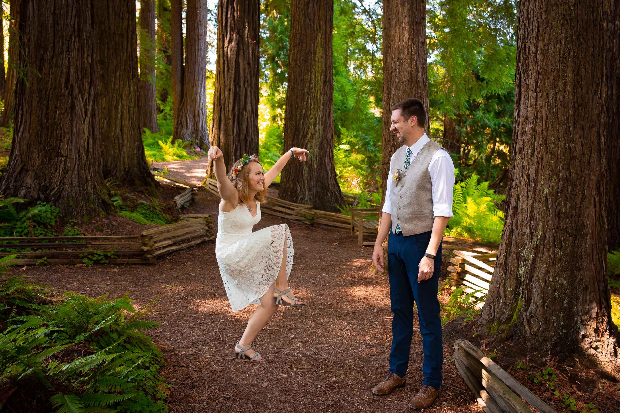 bride doing silly dance for groom at tilden botanical garden
