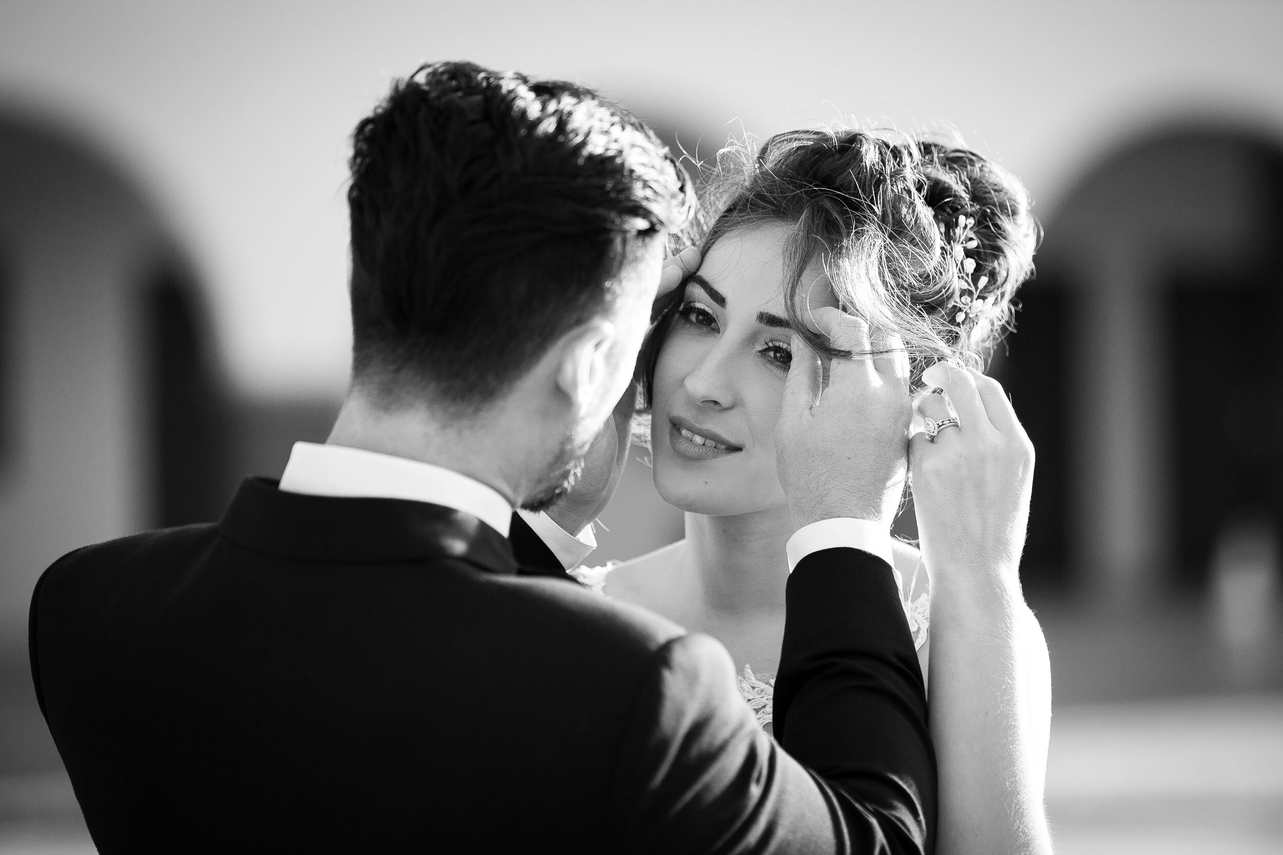 groom-touching-brides-face-during-wedding-at-hotel-mission-de-oro.jpg