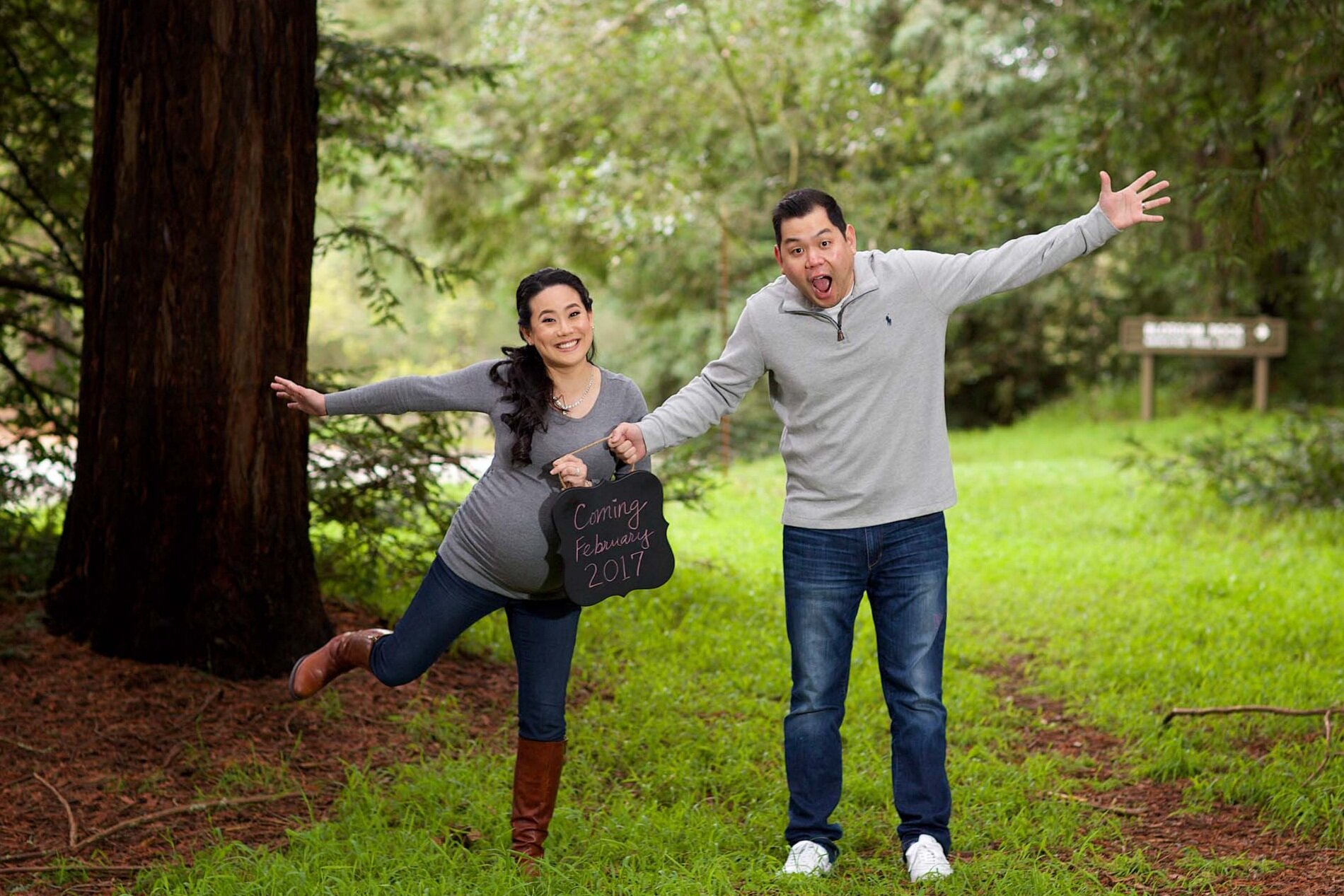 couple-is-excited-during-maternity-photoshoot-at-Redwoods-Roberts-Regional-in-Oakland