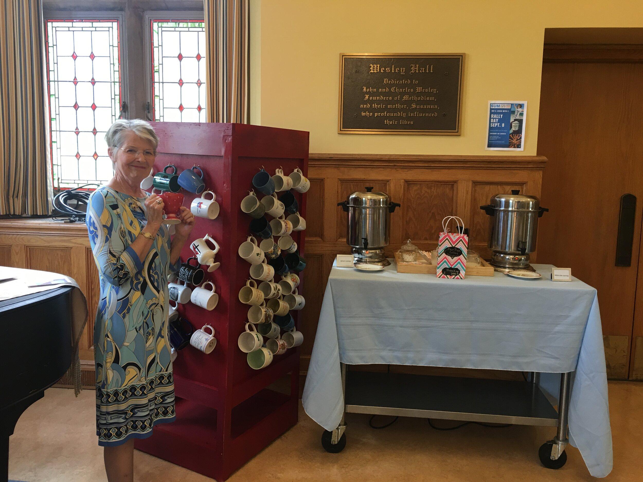 Barbara Vasquenza enjoys a cup of Fair Trade coffee on Rally Day.