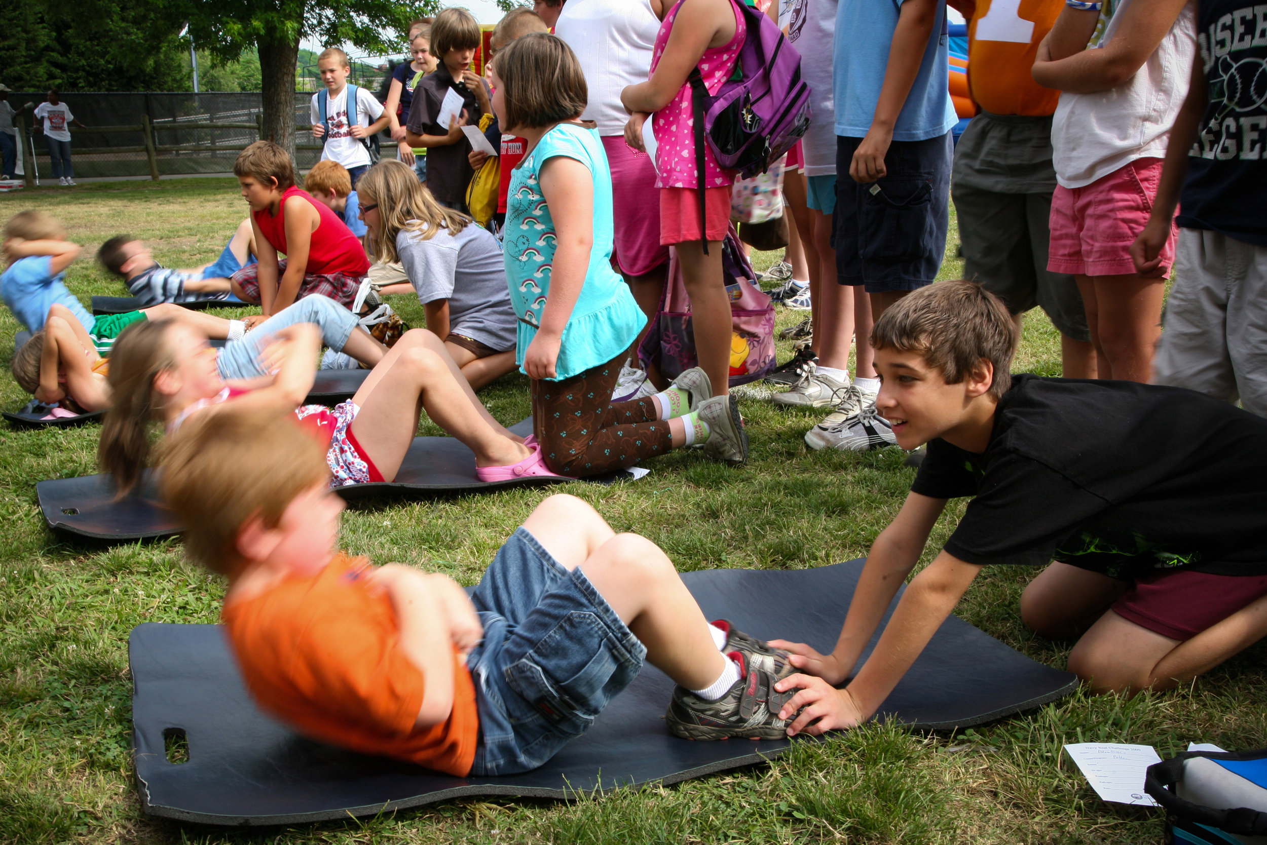 Children performing sit ups, a popular calisthenics exercise.   Image: U.S. Navy photo by Senior Chief Mass Communication Specialist Gary Ward (Wikipedia)