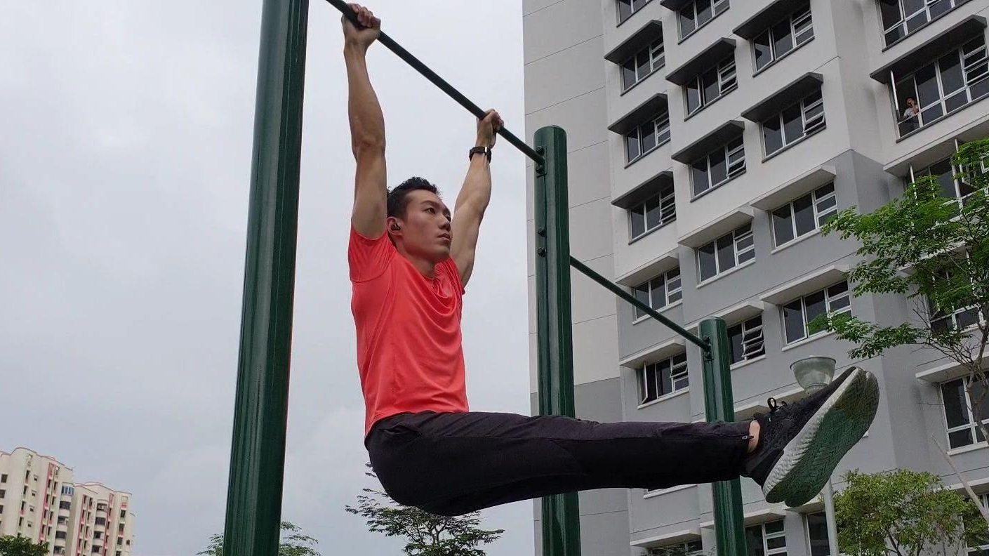 The hanging L-sit, an exercise that requires core stability, pulling strength, and flexibility. Image: Weightless