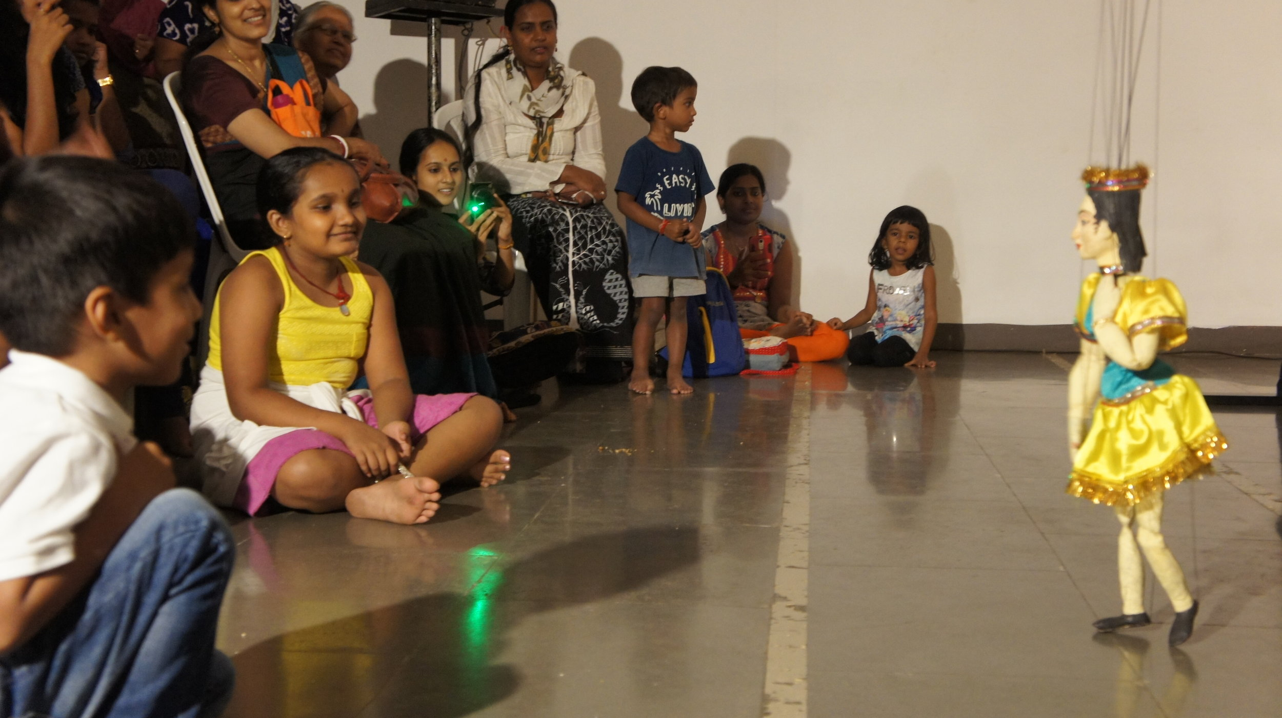 Children watch a puppet show